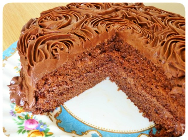 Chocolate fudge cake with chocolate buttercream icing cut view