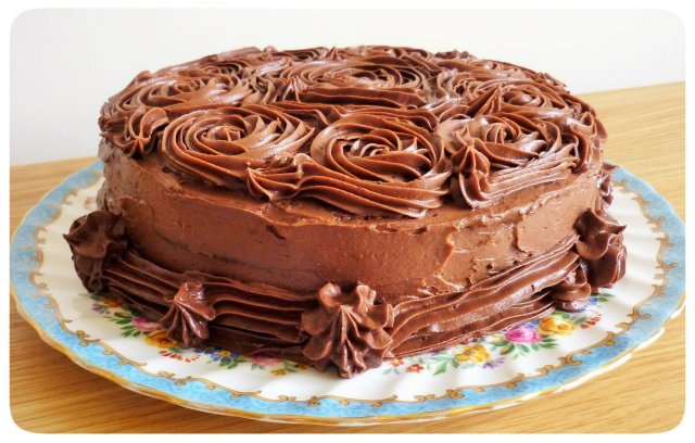 Chocolate fudge cake with chocolate buttercream icing finished view from side