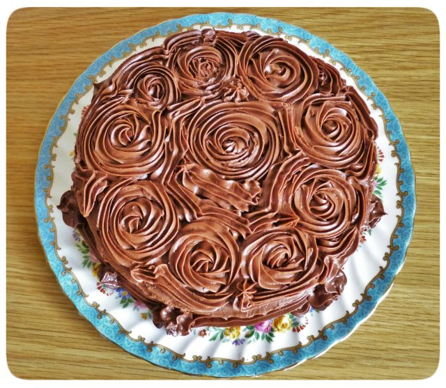 Chocolate fudge cake with chocolate buttercream icing seen from above rosettes