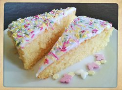 School sponge cake with white icing and sprinkles