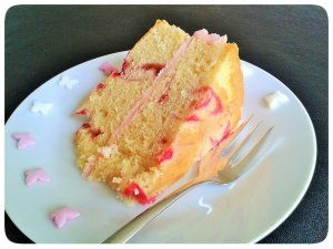 Slice raspberry ripple sandwich cake with raspberry buttercream filling
