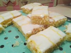 Lemon sponge cake with white icing and yellow feathered icing sliced 6