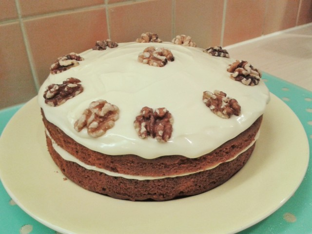 Carrot cake with cream cheese frosting and walnuts
