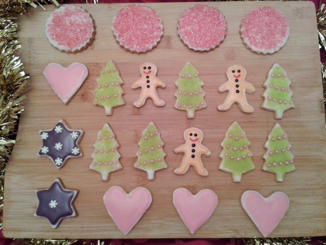 Christmas biscuit cookie selection with various decorations, mini gingerbread men, trees, hearts and stars