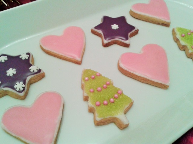 Christmas biscuits cookies heart shapes, christmas trees and purple stars with snowflakes