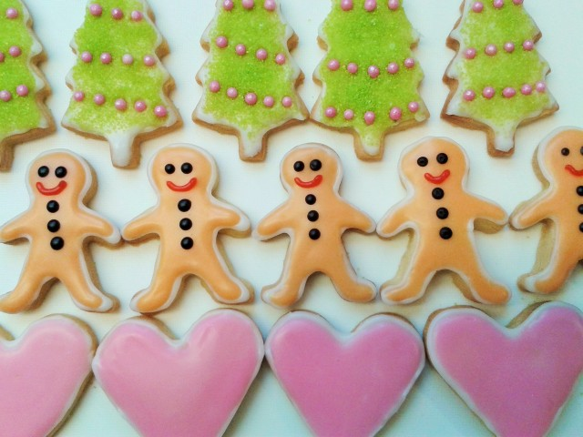 Christmas cookie biscuit selection mini gingerbread men, pink hearts and Christmas tree decoration