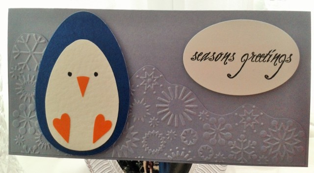 Handmade Christmas card Season's Greetings with a penguin