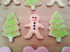 Mini gingerbread Christmas cookies biscuits and Christmas trees with green sparkle decoration
