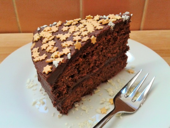 Heavenly chocolate cake with fudge frosting gold sugar stars slice