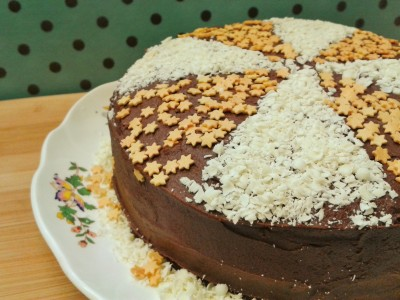 Heavenly chocolate cake with fudge frosting white chocolate shavings and gold sugar stars