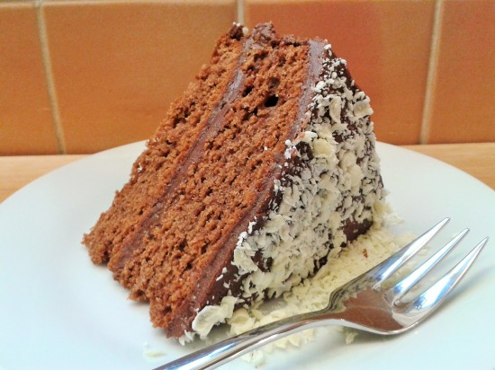 Heavenly chocolate cake with fudge frosting white chocolate shavings slice