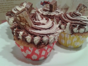 Snickers muffins with chocolate and vanilla buttercream swirl frosting