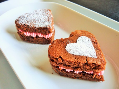 Caramel chocolate brownies heart shaped for Valentine's day with strawberry pink buttercream 1