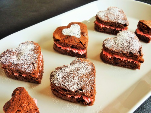 Caramel chocolate brownies heart shaped for Valentine's day with strawberry pink buttercream 2