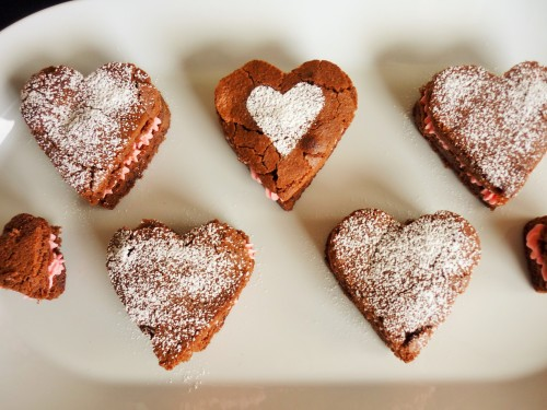 Caramel chocolate brownies heart shaped for Valentine's day with strawberry pink buttercream 3