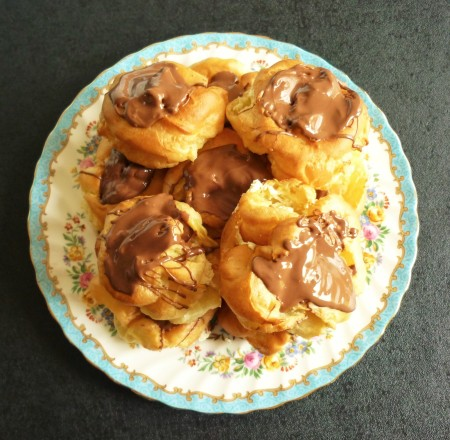 Giant choux buns profiteroles filled with double whipped cream and topped with melted Terry's chocolate orange 3