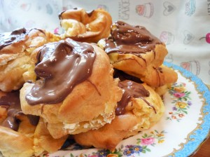 Giant choux buns profiteroles filled with double whipped cream and topped with melted Terry's chocolate orange 4