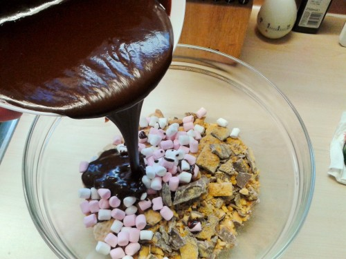 Pouring chocolate mixture onto dry ingredients