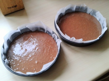 Chocolate easter and spring cake mixture in circular cake tins for sandwich