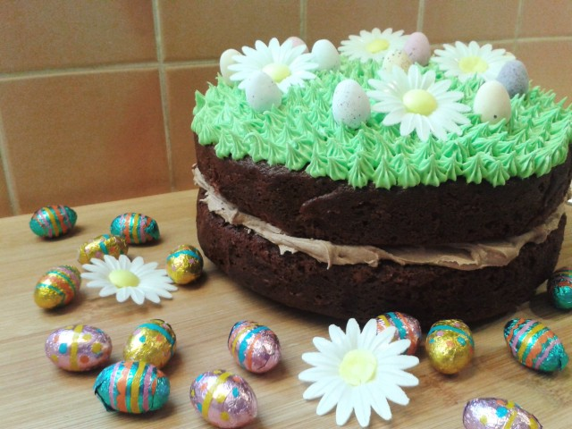 Chocolate easter and spring season cake. Two layer chocolate cake with chocolate buttercream filling and green grass topping frosting decorations with eggs 2