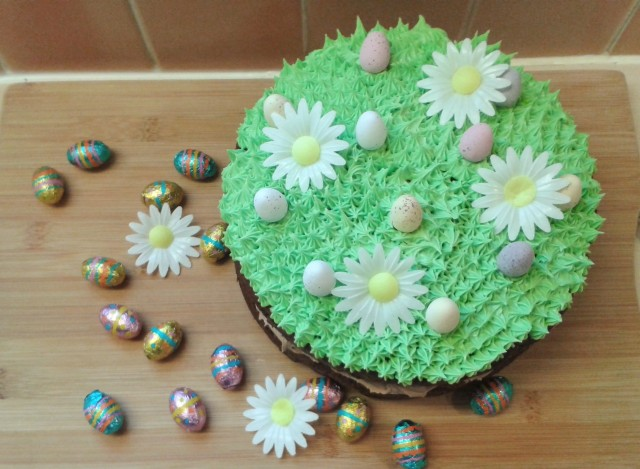 Chocolate easter and spring season cake. Two layer chocolate cake with chocolate buttercream filling and green grass topping frosting decorations with eggs 3