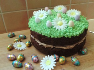 Chocolate easter and spring season cake. Two layer chocolate cake with chocolate buttercream filling and green grass topping frosting decorations with eggs 4