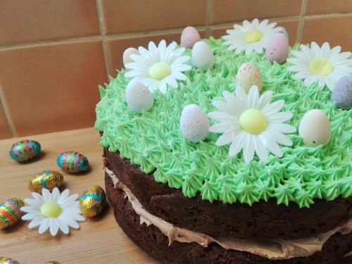 Chocolate easter and spring season cake. Two layer chocolate cake with chocolate buttercream filling and green grass topping frosting decorations with eggs 5