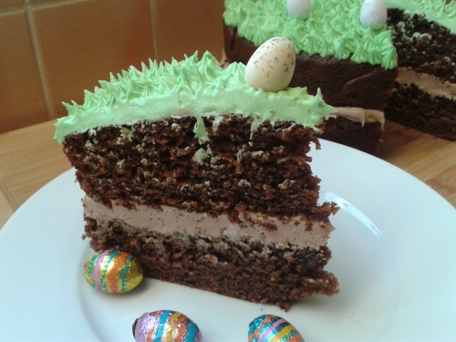 Chocolate easter and spring season cake. Two layer chocolate cake with chocolate buttercream filling and green grass topping frosting decorations with eggs 6