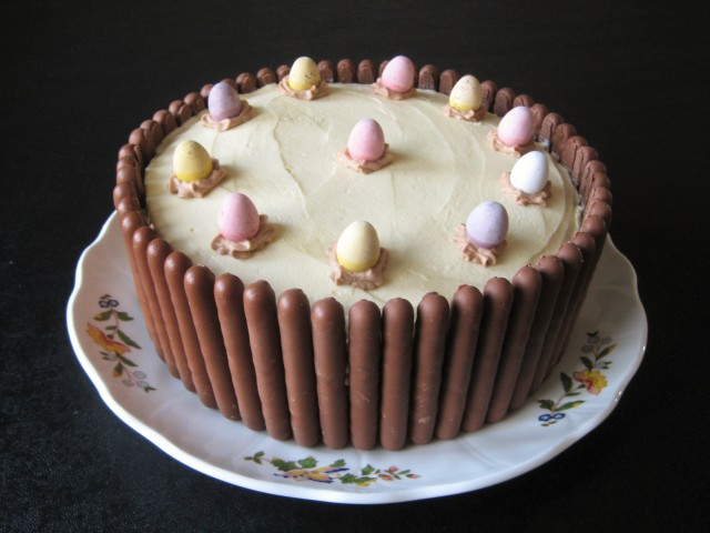 Chocolate finger cake with biscuit border around the edges and mini eggs 1