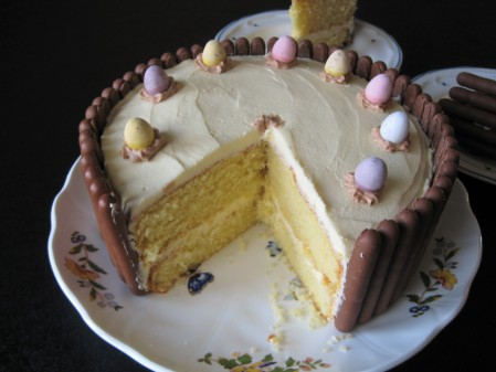 Chocolate finger cake with biscuit border around the edges and mini eggs 4