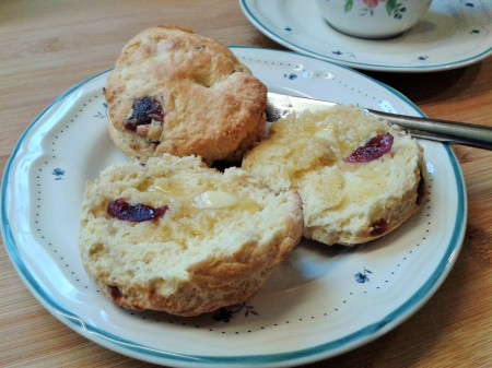 Freshly-baked cherry scones with hot butter