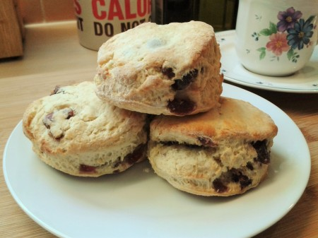 Freshly-baked cherry scones with tea