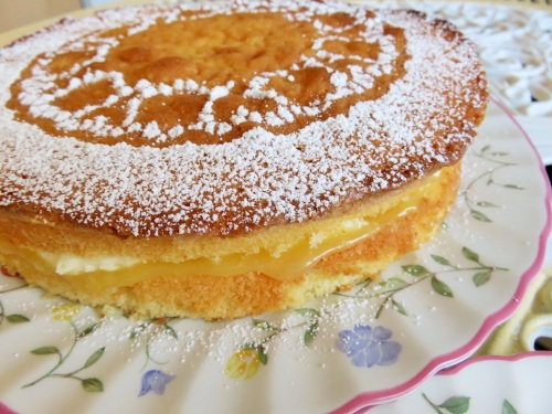 Lemon sponge layer cake with lemon curd and vanilla buttercream filling close up