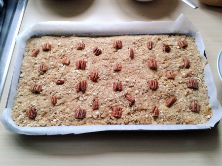Oat and pecan squares with caramel and chocolate making stage 3