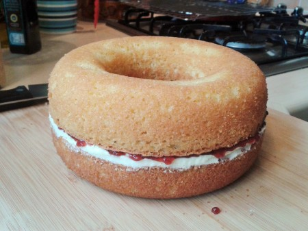 Giant doughnut cake with filling before icing