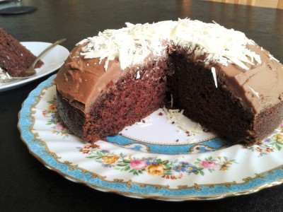 recipe for sooty cake guinness cake with chocolate buttercream icing and white chocolate shavings cut view