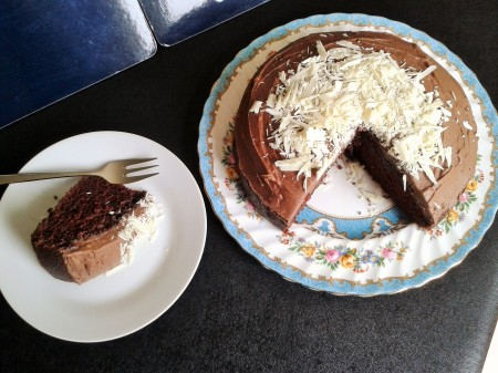 recipe for sooty cake guinness cake with chocolate buttercream icing and white chocolate shavings top view