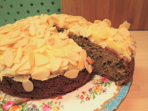 banana-cake-recipe-with-buttercream-icing-and-flaked-almonds