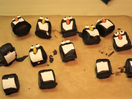 marshmallow-penguins-decorating-with-smartie-beaks-and-candy-eyes
