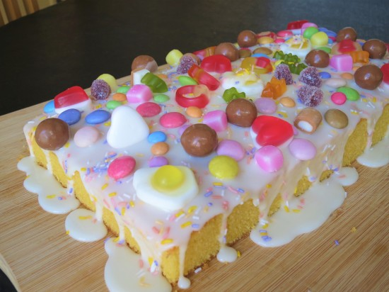 Orange sweetie tray bake cake easy uk recipe with white icing and haribo