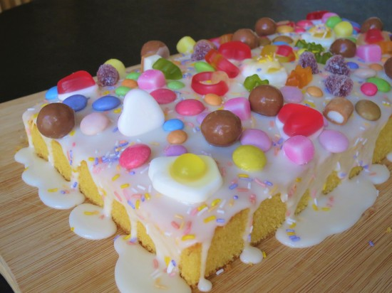 Orange sweetie tray bake cake easy uk recipe with white icing with dolly mixtures