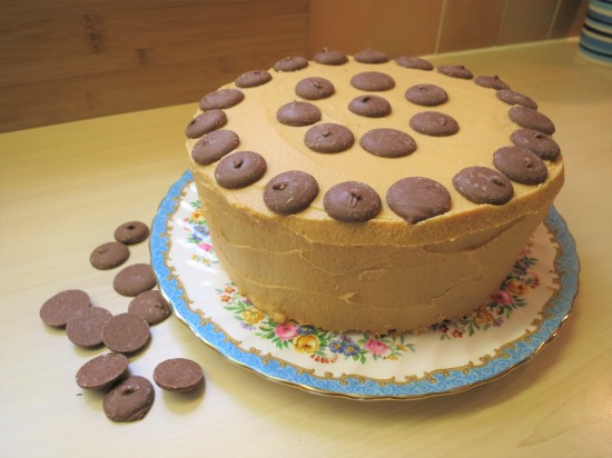 Easy chocolate vanilla and caramel layer cake with caramel buttercream frosting and chocolate caramel buttons uk recipe