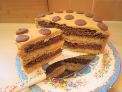 Easy chocolate vanilla and caramel layer cake with caramel buttercream frosting and chocolate caramel buttons uk simple recipe