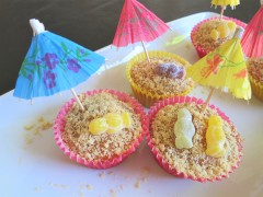 Salted caramel and jelly baby sunbathers beach cupcakes uk recipe with cocktail umbrellas featured