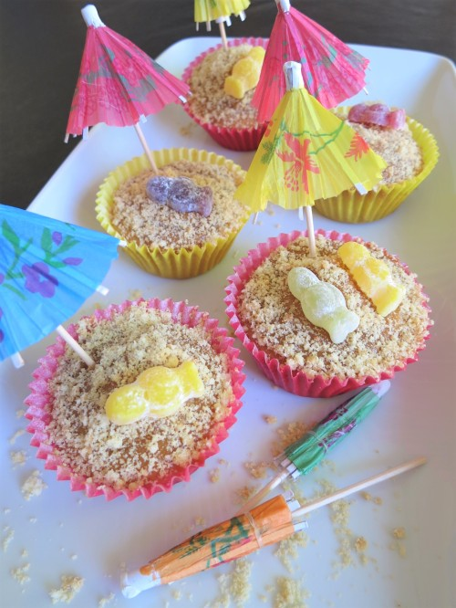 Salted caramel and jelly baby sunbathers beach cupcakes uk recipe with cocktail umbrellas
