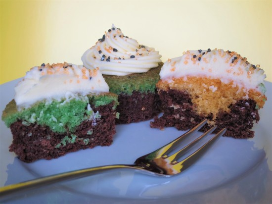 Halloween brownie cupcakes with orange and green sponge quick Halloween baking recipe for kids UK with buttercream and sprinkles inside view
