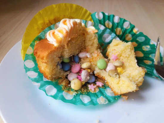 Piñata pinata cupcakes recipe made using condensed milk and hidden centre sweeties and multicoloured icing