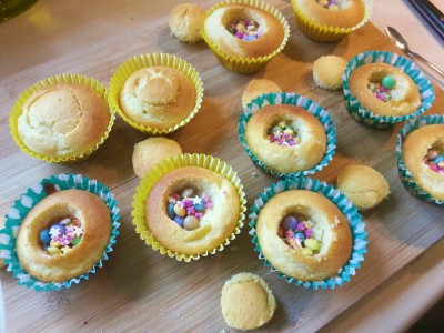Piñata pinata cupcakes uk recipe made using condensed milk and hidden centre sweeties and multicoloured icing