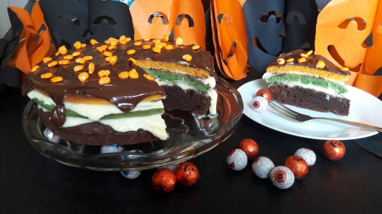 Halloween chocolate brownie and sponge layer cake orange and green with chocolate recipe uk party ideas