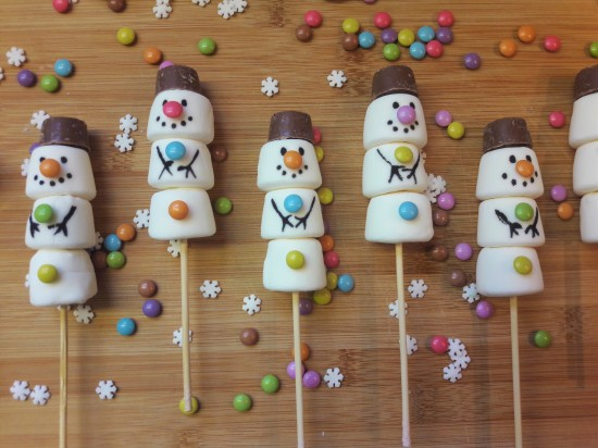 Festive marshmallow snowmen with chocolate hats and buttons